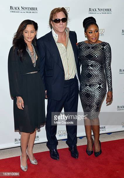 Persia White Mickey Rourke and Mbong Amata attend the Black November New York Premiere at United Nations on September 26 2012 in New York City