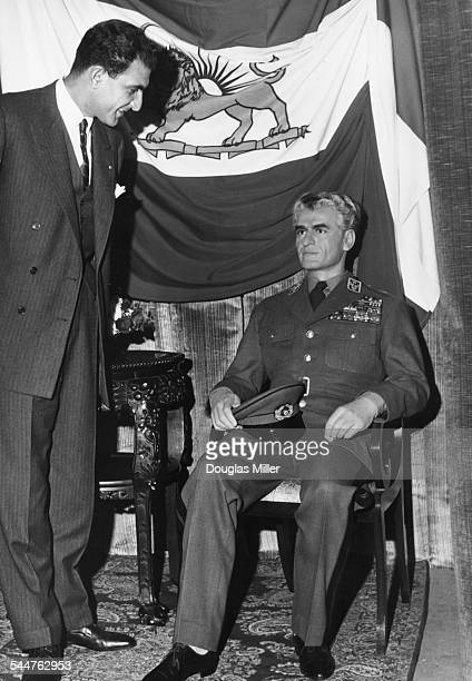 Persian Ambassador Ardeshir Zahedi viewing the waxwork effigy of the Shah of Persia at Madame Tussauds London October 25th 1962