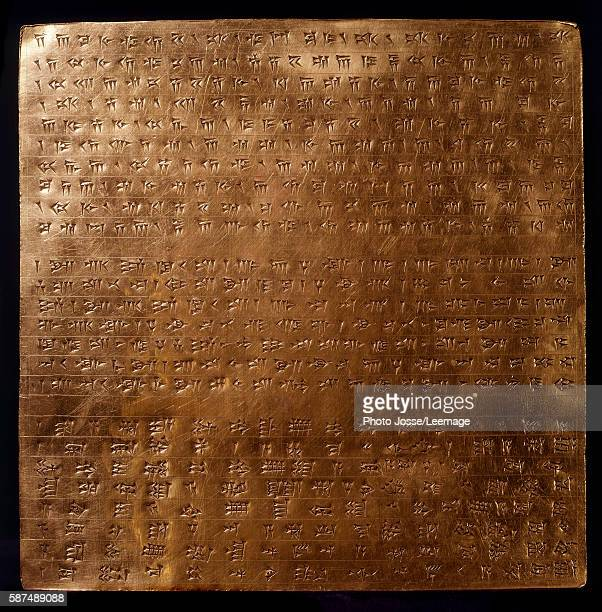 gold plate of Achaemenid king Darius I engraved with inscriptions in cuneiform writing550500 BC from Persepolis Archaeological MuseumTeheranIran