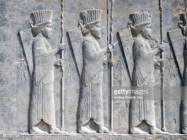 persian empire soldiers bas relief, persepolis, iran - bas relief stock pictures, royalty-free photos & images