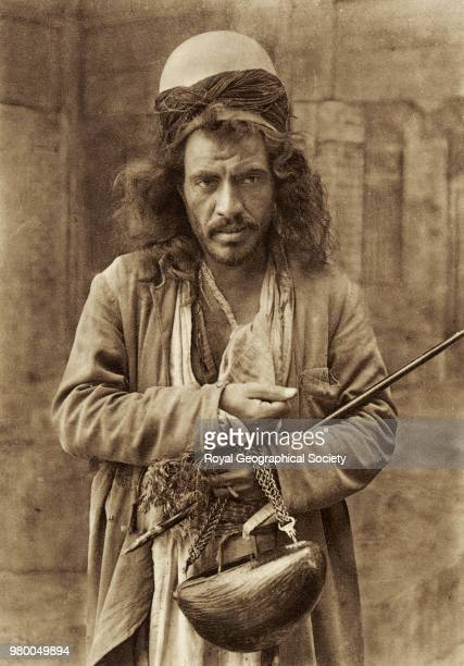 Persian fakir This photograph shows a sufi/dervish holding kashkul and a staff Iraq 1940