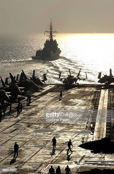 Persian Gulf, December 3, 2005 - The Spanish Navy frigate Alvaro de Bazan (F101) pulls away from the Nimitz-class aircraft carrier USS Theodore Roosevelt (CVN 71) after a ceremony honoring the departure of the ship from Carrier Strike Group Two (CSG-2).