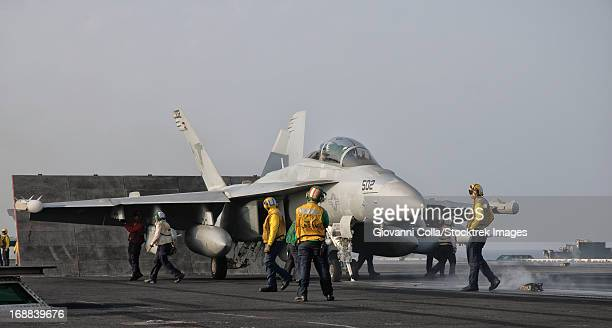 Persian Gulf, October 30, 2011 - An EA-18G Growler is guided into catapult aboard USS George H.W. Bush.
