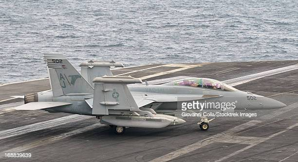 Persian Gulf, October 30, 2011 - An EA-18G Growler moves to parking aboard USS George H.W. Bush.