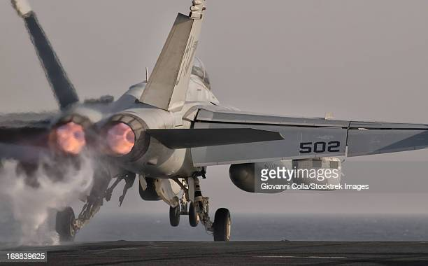 persian gulf, october 30, 2011 - an ea-18g growler taking off from the flight deck of uss george h.w. bush. - 航空母艦 ストックフォトと画像