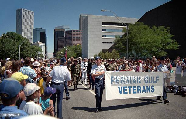 persian gulf war veterans independence day parade downtown denver colorado - iraq war stock pictures, royalty-free photos & images