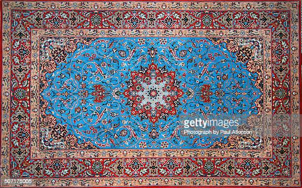 persian isfahan carpet - persian rug stock photos and pictures