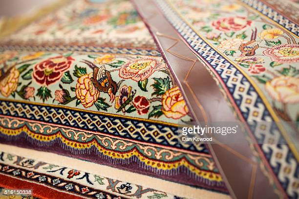 A persian 'Isfahan' rug is displayed at the Oriental Rug Centre's main warehouse on March 17 2016 in London England The Oriental Rug Centre in North...
