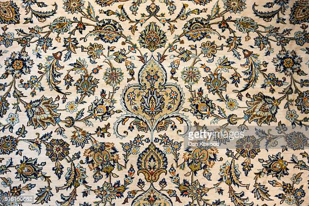Persian 'Isfahan' Rug is displayed at the Oriental Rug Centre's main warehouse on March 17 2016 in London England The Oriental Rug Centre in North...