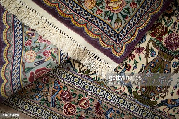 Persian 'Isfahan' rugs are displayed at the Oriental Rug Centre's main warehouse on March 17 2016 in London England The Oriental Rug Centre in North...