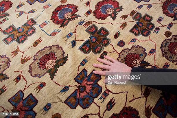 Persian 'Malayer' Persian Rug is displayed at the Oriental Rug Centre's main warehouse on March 17 2016 in London England The Oriental Rug Centre in...
