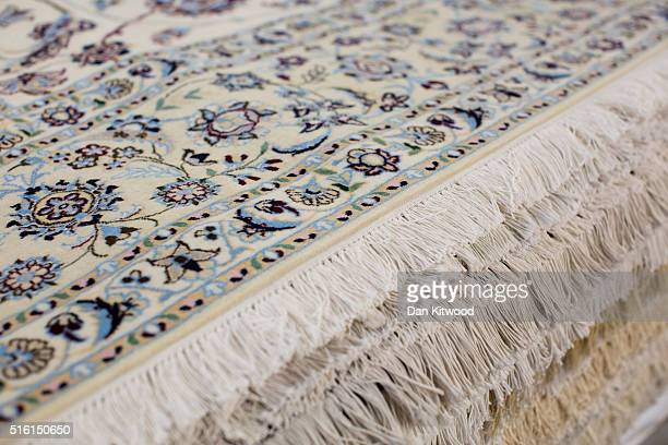 Persian 'Nain' rug is displayed at the Oriental Rug Centre's main warehouse on March 17 2016 in London England The Oriental Rug Centre in North...