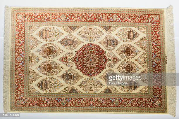 Persian 'Qom' rug is displayed at the Oriental Rug Centre's main warehouse on March 17 2016 in London England The Oriental Rug Centre in North London...