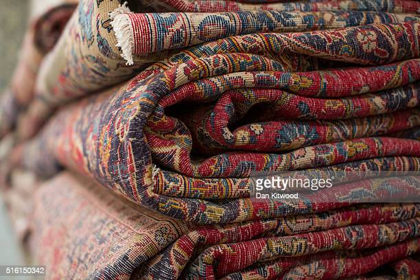 Persian rugs are piled at the Oriental Rug Centre's main warehouse on March 17 2016 in London England The Oriental Rug Centre in North London is one...