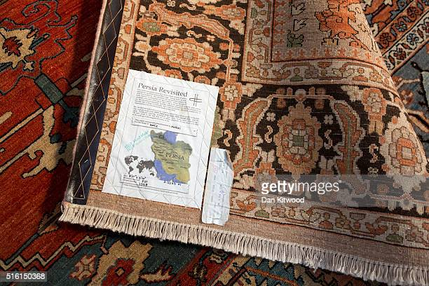 Persian rugs with reproductions of original antique designs are displayed at the Oriental Rug Centre's main warehouse on March 17 2016 in London...