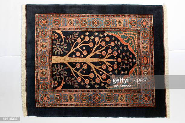 Persian 'Sarouk' rug is displayed at the Oriental Rug Centre's main warehouse on March 17 2016 in London England The Oriental Rug Centre in North...