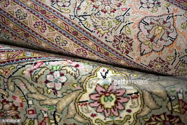 A persian 'Tabriz' rug is displayed at the Oriental Rug Centre's main warehouse on March 17 2016 in London England The Oriental Rug Centre in North...