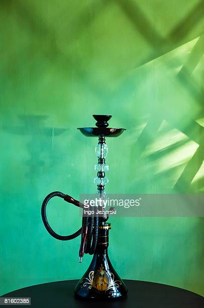 Persian water pipe on table