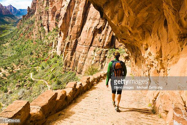 Persian woman hiking on canyon path