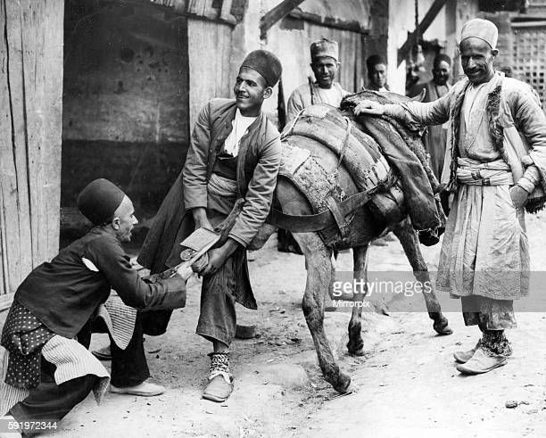 Persians shoeing a mule in Hamadan capital city of Hamadan Province of Iran Circa 1926 Hamadan is believed to be among the oldest Iranian cities and...