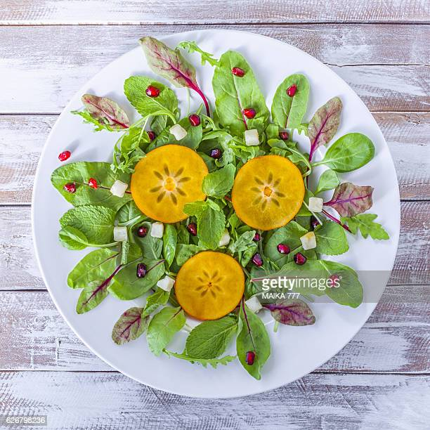 Persimmon, Caqui or Kaki, salad with vegan cream cheese