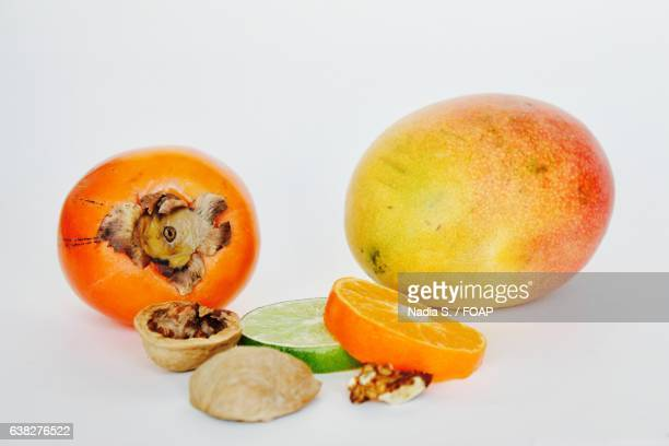 Persimmon, lime slice with nuts