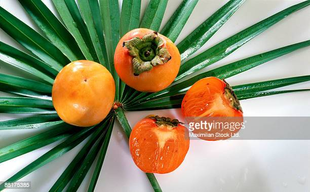 Persimmons on palm leaf