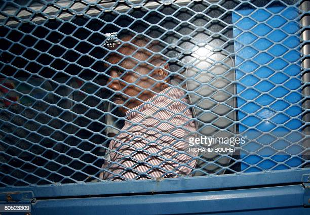 A person accompanying ousted leader of the Comoros island of Anjouan Mohamed Bacar is taken to the prison on April 4 2008 in SaintDenis de la Runion...