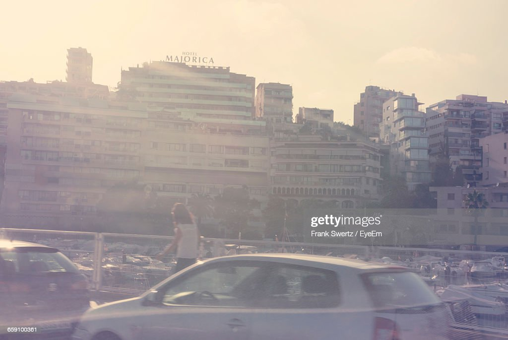 Person And Cars Against Buildings In City : Stock-Foto