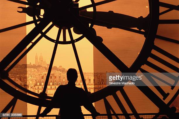 person and clock face - musee d'orsay stock pictures, royalty-free photos & images