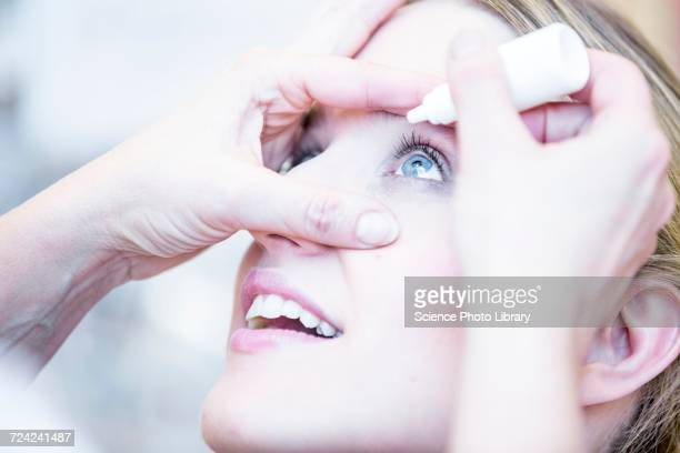 Person applying eye drops