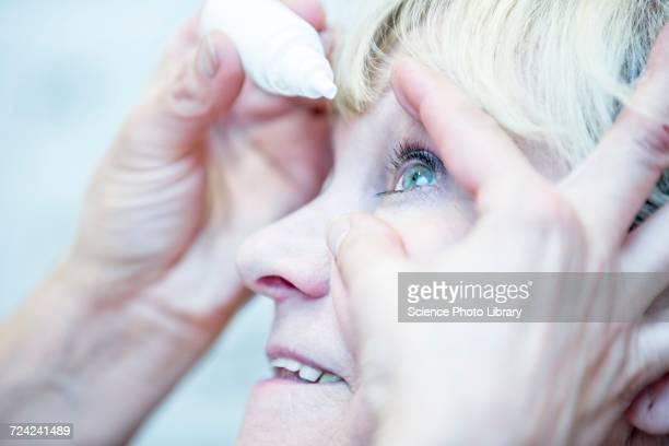 Person applying eye drops