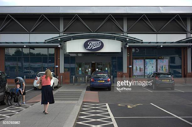 A person approaching Boots the UK pharmacy and beauty chain in central Stockport
