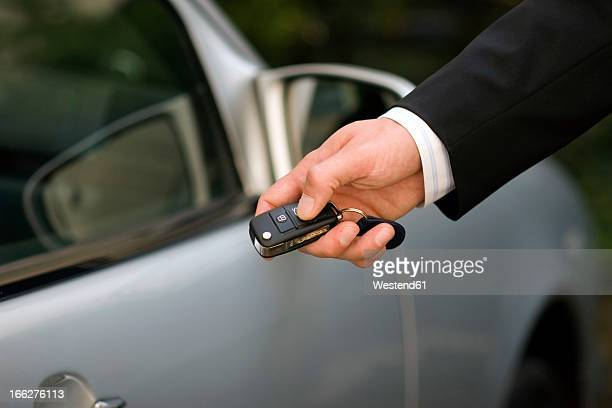 Person at car using remote control key, close-up