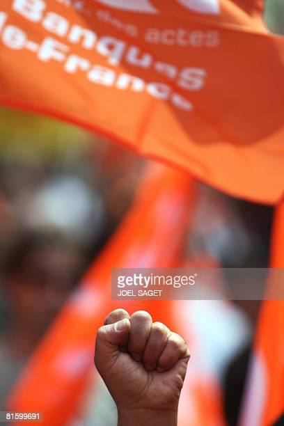 A person attends a demonstration of thousands people as part of a nationwide strike called by the two biggest unions CGT and CFDT on June 17 2008 in...