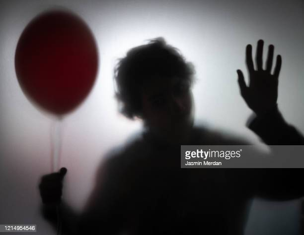 person behind glass spooky sillhouette - horror movie stock pictures, royalty-free photos & images