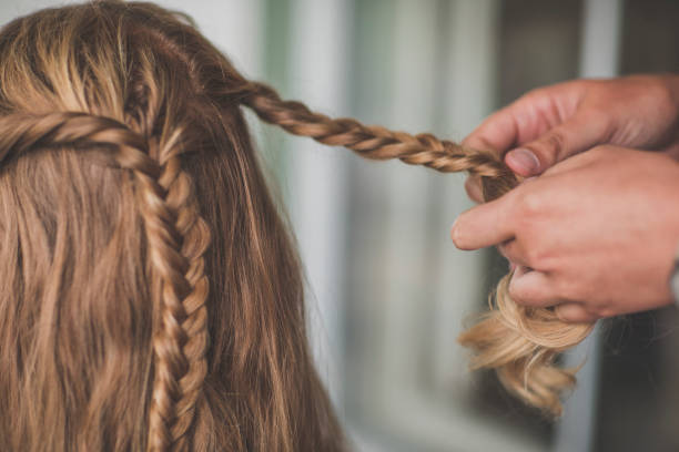 person braiding hair of woman, abbotsford, british columbia, canada - braids stock pictures, royalty-free photos & images