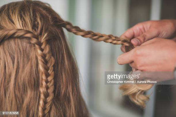 Person braiding hair of woman, Abbotsford, British Columbia, Canada