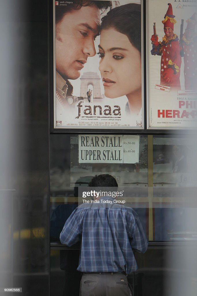 A person buying ticket of the newly launched Aamir Kajol starrer