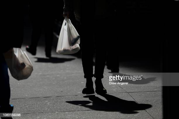 A person carries a plastic bag during the lunch hour in Lower Manhattan January 15 2019 in New York City New York Governor Andrew Cuomo is planning...