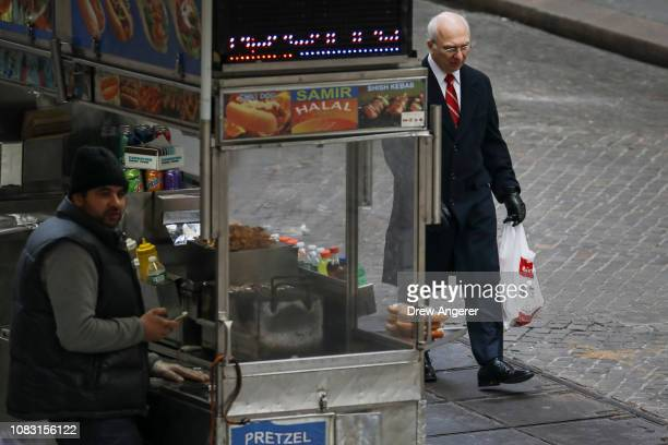 A person carries a plastic bag in Lower Manhattan January 15 2019 in New York City New York Governor Andrew Cuomo is planning to push for a statewide...