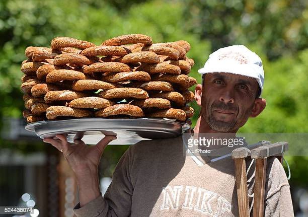 A person carries a traditional Turkish simit images from the start of the 132km Fethiye Marmaris fourth stage of the 51st Presidential Cycling Tour...