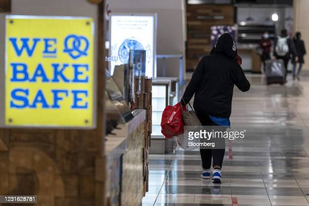 Person carries shopping bags inside the Westfield San Francisco Centre shopping mall in San Francisco, California, U.S., on Tuesday, March 9, 2021....