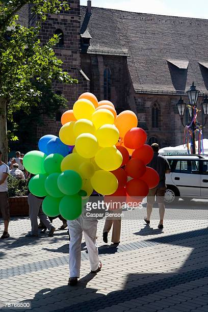 A person carrying a bunch of balloons