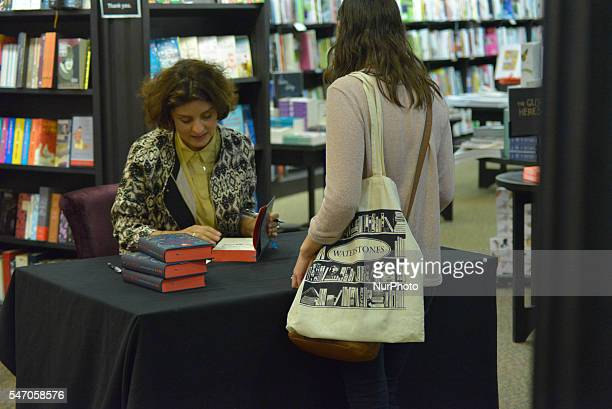 A person carrying a Waterstone's canvas bag as Jessie Burton signs a copy her new novel 'The Muse' on July 12th at the Deansgate branch of...