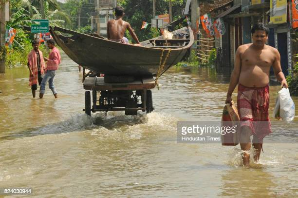 A person carrying in boat in flood affected Shehagori village of Amta Block II Howrah on July 28 2017 near Kolkata India Flood situation in Bengal...