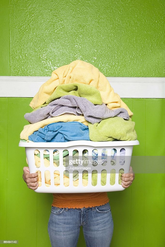 Person carrying laundry basket : Stock Photo