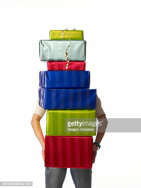 Person carrying stack of presents