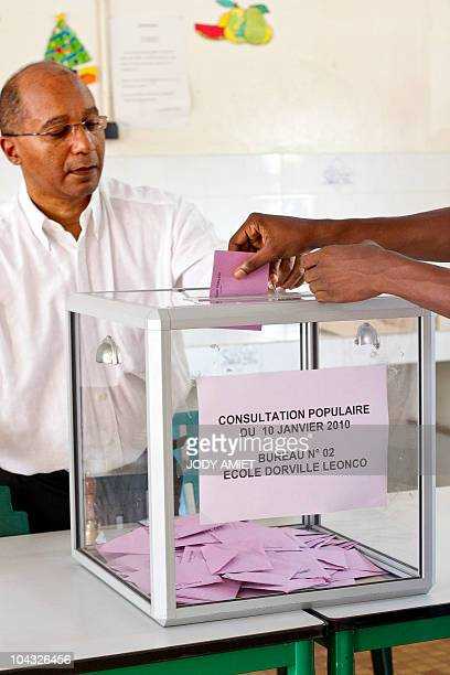 A person casts her ballot in the polling station of Cayenne on the French South American territory of Guiana on January 10 for the referendum on the...