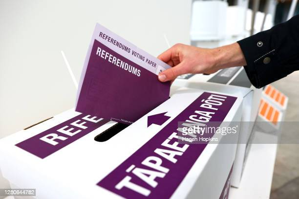 Person casts their referendum vote during election day on October 17, 2020 in Wellington, New Zealand. Voters head to the polls today to elect the...
